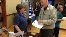 "Donna Gagnon chats with an attendee about researching your family tree in her session ""We Go Back"" held in Bancroft"