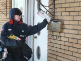 Letter carrier Karen McKinley delivers mail on Ayer Avenue in Moncton. Photo: RON WARD/TIMES & TRANSCRIPT