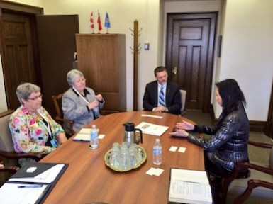 Susan Eng, Bernice Rempel and Louise Yarrow meet with the Alberta Minister of Finance, Hon. Doug Horner