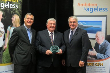 Dr. Edgar Williams (centre) St. John's-Avalon Chapter Chair receives 2014 Seniors of Distinction Award from (R) the Hon. Clyde Jackman, NL Minister of Seniors and (L) Kevin Pollard, Parliamentary Assistant