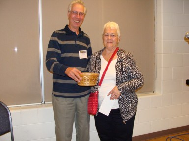 Lois Frederikse, shown with Chapter volunteer Hugh Cass,  won $95