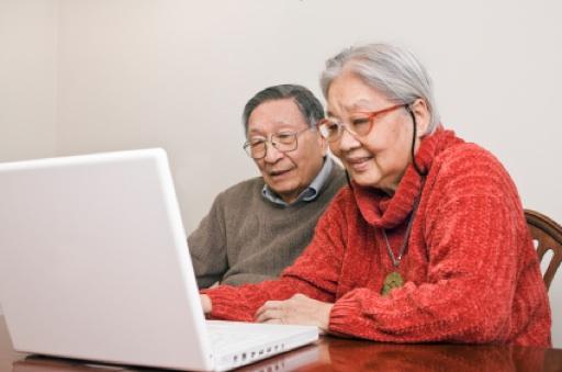 Senior-Couple-At-Computer