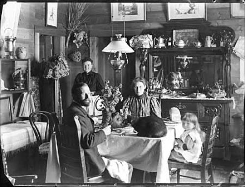 My great-grandfather and great-grandmother are pictured here having breakfast with their infant son (my grandfather) , at their home in Fort MacLeod.