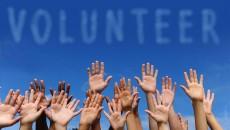 bigstock_volunteer_group_raising_hands__19543958