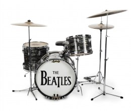 """This undated photo provided by Julien's Auctions shows Beatle Ringo Starr's first 1963 Ludwig Oyster Black Pearl three-piece drum kit, used by Starr in more than 200 performances in 1963 and 1964. The set was used to record some of the Beatles' biggest hits, including """"Can't Buy Me Love,"""" """"She Loves You,"""" """"All My Loving,"""" and """"I Want to Hold Your Hand."""" More than 800 items owned by Starr and his wife, Barbara Bach, are going to auction. The unprecedented number of Beatles-owned objects will be offered Dec. 4-5, 2015, at Julien's Auctions in Beverly Hills, Calif. (Julien's Auctions via AP)"""