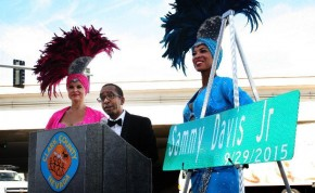 This photo provided by Erik Pappa, Clark County communication director, shows Manny Davis son of Sammy Davis Jr. talks during a dedication ceremony to rename a street in his father's name in Las Vegas, Tuesday, Sept. 29, 2015. The ceremony was held at the three-way intersection where Sammy Davis Jr. Drive, Frank Sinatra Drive and Dean Martin Drive meet. (Erik Pappa/Clark County, Nevada via AP)
