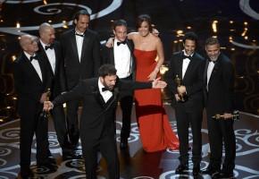 """HOLLYWOOD, CA - FEBRUARY 24: Actor/producer/director Ben Affleck accepts the Best Picture award for """"Argo"""" along with members of the cast and crew onstage during the Oscars held at the Dolby Theatre on February 24, 2013 in Hollywood, California. (Photo by Kevin Winter/Getty Images)"""