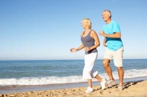 older-couple-running-beach-11072102