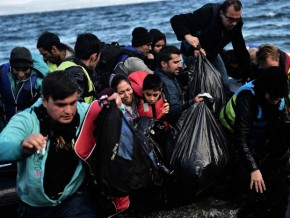 Refugees and migrants arrive on the Greek island of Lesbos on October 25, 2015 after they crossed the Aegean sea from Turkey.  At least three migrants -- two children and a woman -- drowned when their boat sank off the Greek island of Lesbos, the coastguard said, the latest fatalities in Europe's refugee crisis. Around a dozen others, mostly Afghans, are still missing after the rickety vessel, carrying 60 people, went down at dawn as it made the perilous crossing from Turkey, according to the Greek coastguard. AFP PHOTO / ARIS MESSINISARIS MESSINIS/AFP/Getty Images