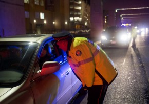 TORONTO, ONTARIO: DECEMBER 14, 2012 -- RIDE PROGRAM -- Police officers stop motorists during a RIDE program spot-check on Lakeshore Blvd. in Toronto Thursday, December 13, 2012.  (Darren Calabrese/National Post)    //s3.amazonaws.comNATIONAL POST STAFF PHOTO ADD: Drinking and driving drunk alcohol roadside spotcheck TPS Toronto Police Service liquor /pws ORG XMIT: POS1212141135126288