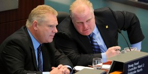 CAJKWG Jan. 10, 2011 - Toronto, Ontario, Canada - - Mayor Ford (right) chats with his brother Councillor Doug Ford (left) as councillors discuss the budget..Mayor Rob Ford today announced his 2011 city budget at City Hall.  There is no property tax increase but small cuts and service fees are found in many