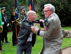 A protester is tackled by the Canadian Ambassador to Ireland, Kevin Vickars at the state event marking the deaths of British Soldiers in The Easter Rising at Grangegorman cemetery today. Photo: Tony Gavin 26/5/2016